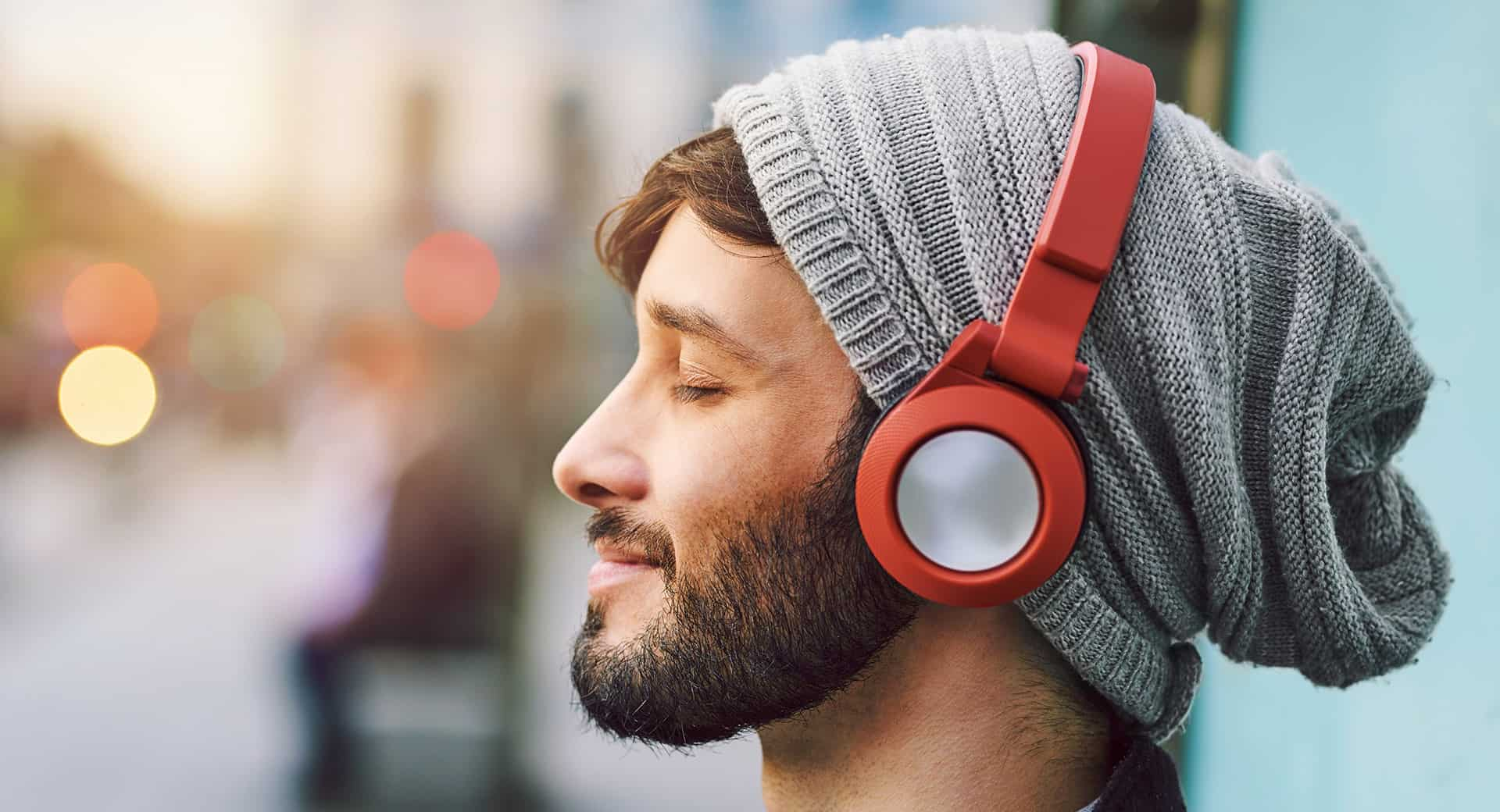Man wearing red headphones